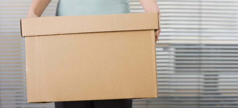 person holding a box