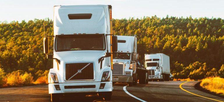 Three trucks on a road